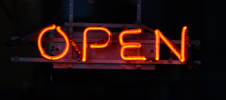 neon open sign on dark background