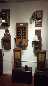 Old telephones on a white wall