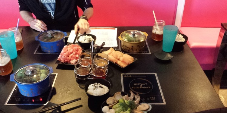 Hot Pot table with food and pink wall