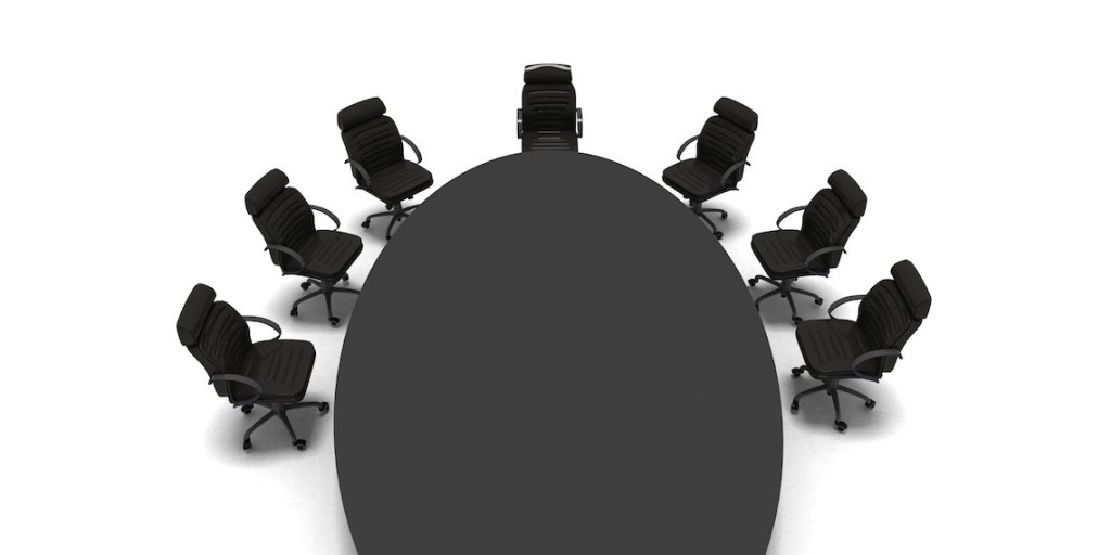 black chairs around black table on white background