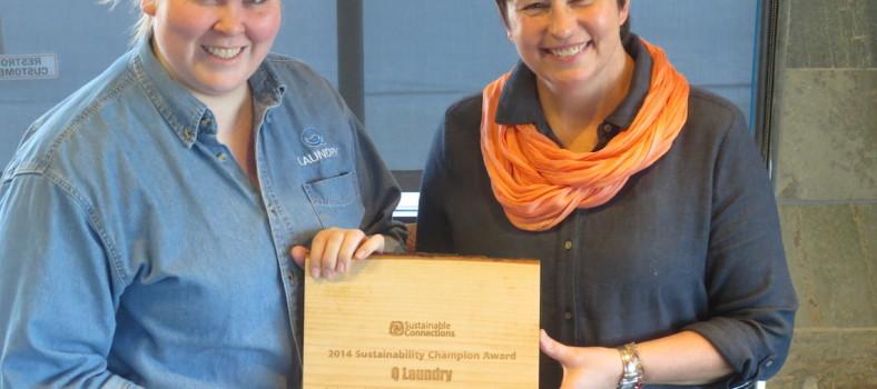 Q Laundry Employees hold up award